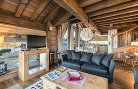 Cosy alpine living room luxury family apartment Tiama Courchevel 1850